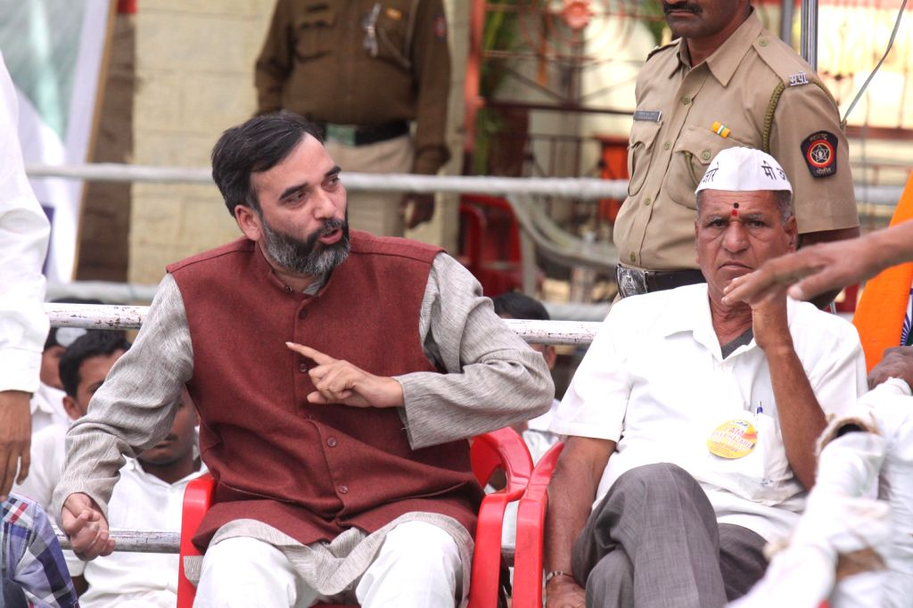 Aam Aadmi Party (AAP) leader Gopal Rai interrupts General V K Singh's speech at the venue where social activist Anna Hazare is sitting on indefinite hunger strike for passage of Jan  in ...
