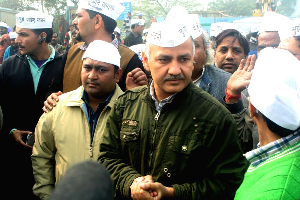 Aam Aadmi Party (AAP) leader Manish Sisodia and other party workers protest against demolition of a slum in Mayur Vihar  Phase -1 of New Delhi on Dec.20, 2013.