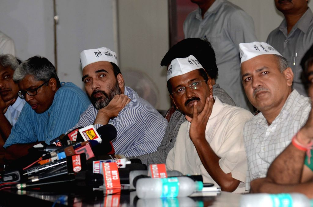 Aam Aadmi Party (AAP) leaders Ashutosh, Gopal Rai, Arvind Kejriwal,and Manish Sisodia during a press conference in New Delhi on Sept 8, 2014. - Gopal Rai and Arvind Kejriwal