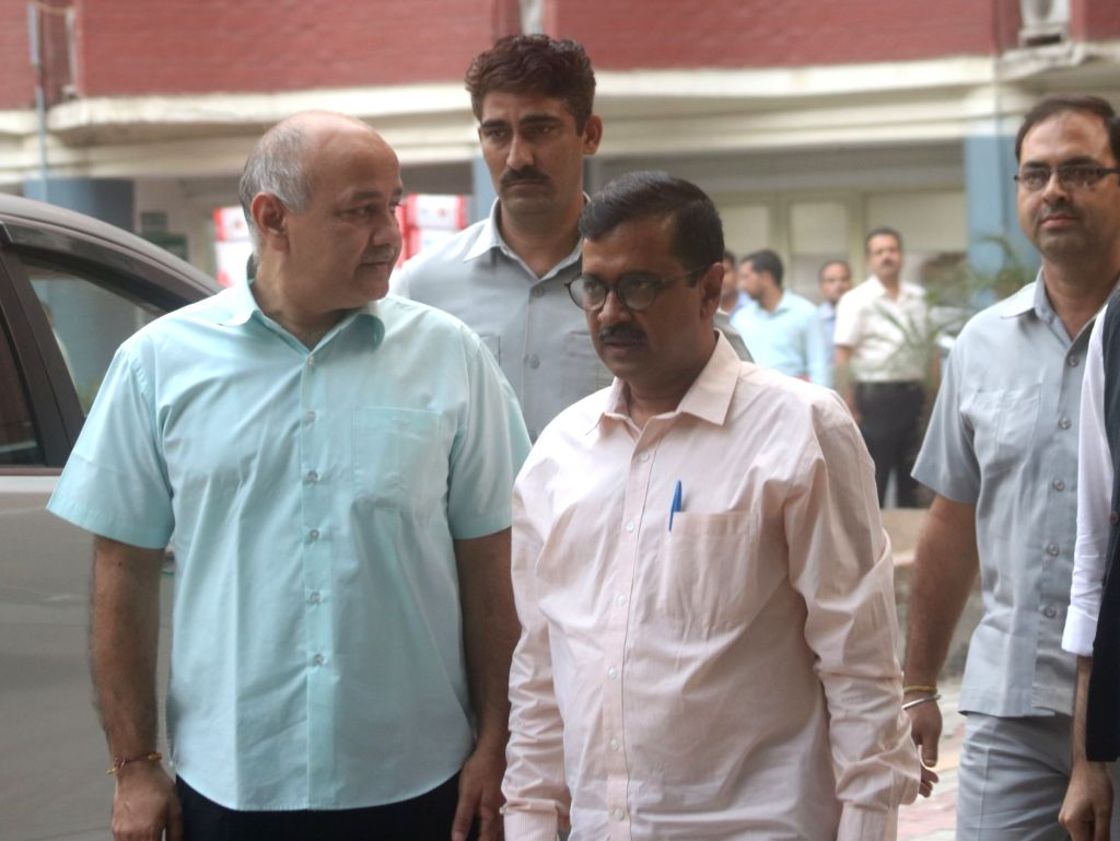 Aam Aadmi Party (AAP) leaders - Delhi Chief Minister Arvind Kejriwal, Deputy Chief Minister Manish Sisodia and spokesperson Raghav Chadda after meeting the Chief Election Commissioner ... - Arvind Kejriwal