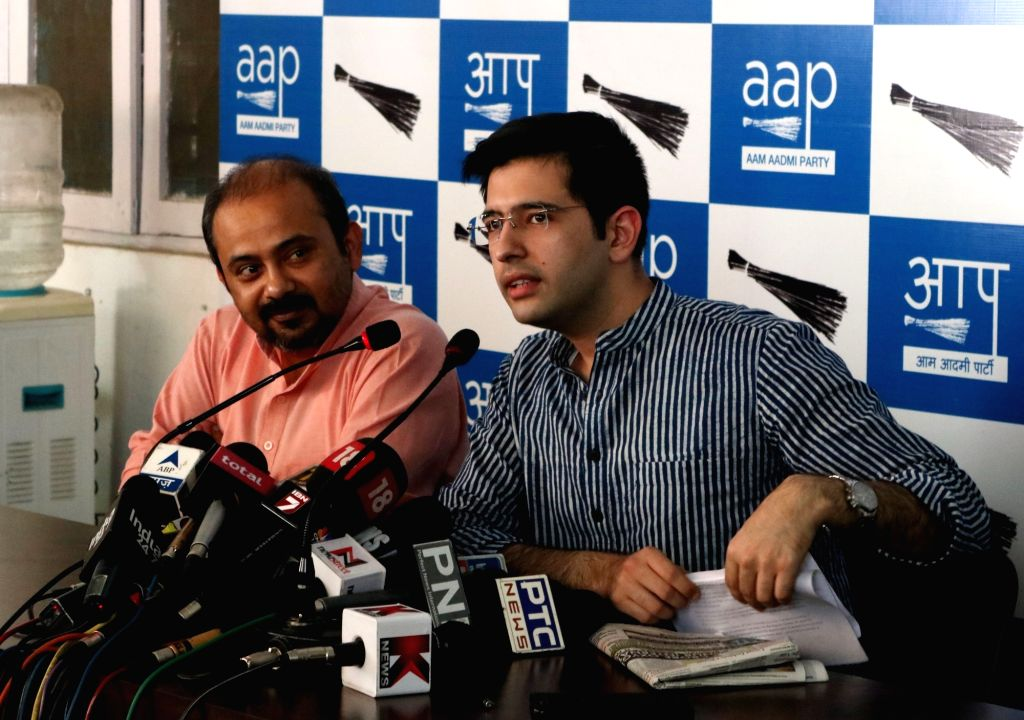 Aam Aadmi Party (AAP) leaders Dilip Pandey and Raghav Chadha during a press conference in New Delhi on June 18, 2016. - Dilip Pandey