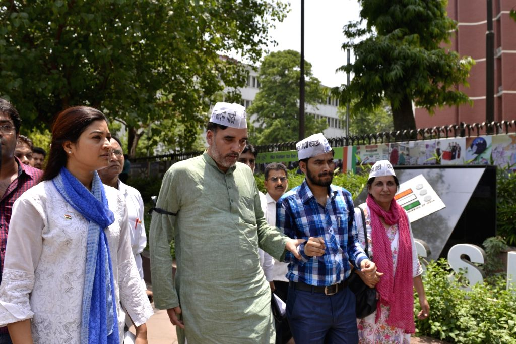 Aam Aadmi Party (AAP) leaders Gopal Rai and Alka Lamba arrive to meet Election Commissioner at Nirvachan Sadan in New Delhi on May 11, 2017. - Gopal Rai
