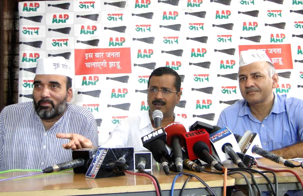 Aam Aadmi Party (AAP) leaders Gopal Rai, Arvind Kejriwal and Manish Sisodia during a press conference at Kaushambi on Sept 9, 2014. - Gopal Rai and Arvind Kejriwal