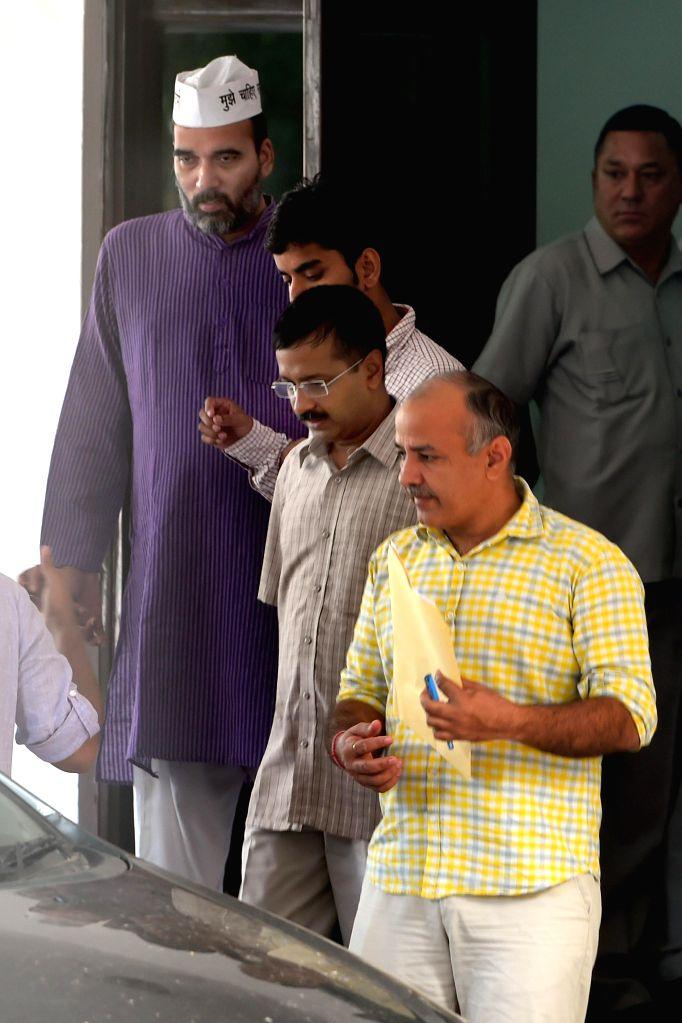 Aam Aadmi Party (AAP) leaders  Gopal Rai, Arvind Kejriwal and Manish Sisodia at LG House in New Delhi on Sept 10, 2014. - Gopal Rai and Arvind Kejriwal