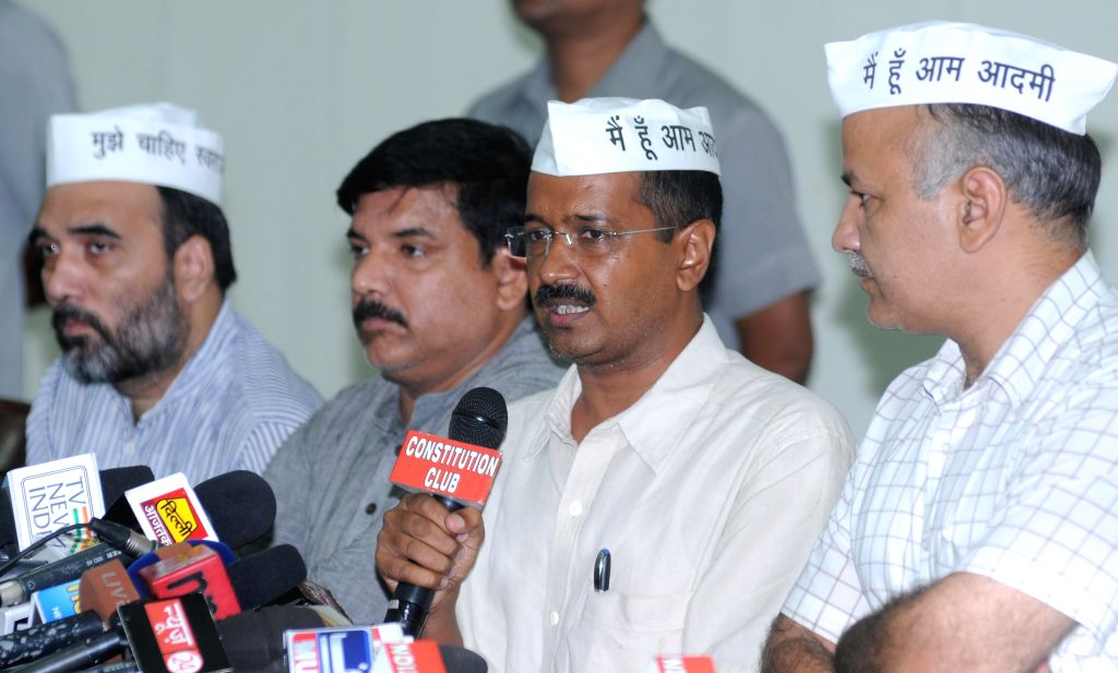 Aam Aadmi Party (AAP) leaders Gopal Rai, Sanjay Singh, Arvind Kejriwal and Manish Sisodia during a press conference in New Delhi on Sept 8, 2014. - Gopal Rai, Sanjay Singh and Arvind Kejriwal