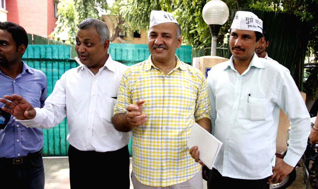 Aam Aadmi Party (AAP) leaders including Manish Sisodia and Somanth Bharti outside the residence of party leader Arvind Kejriwal after a meeting in New Delhi on July 17, 2014. - Arvind Kejriwal