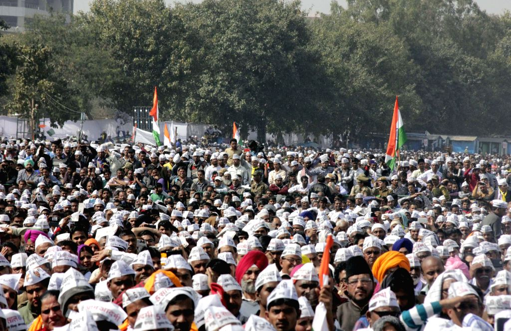 Aam Aadmi Party (AAP) supporters at the swearing-in ceremony of Delhi Chief Minister Arvind Kejriwal at at Ramlila Maidan in New Delhi, on Feb 14, 2015. - Arvind Kejriwal