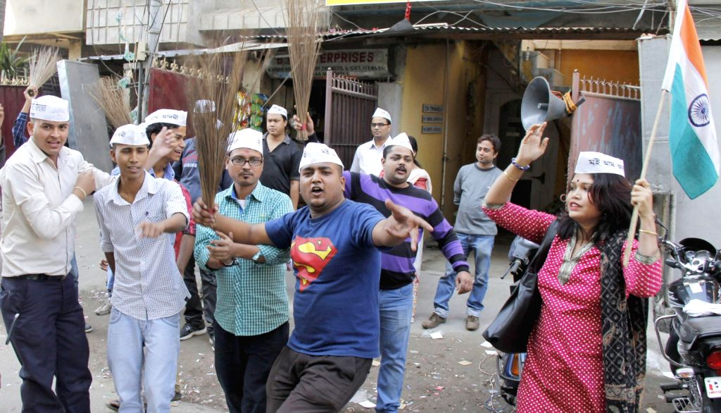 Aam Aadmi Party (AAP) supporters celebrate after a stunning performance of the party in Delhi Assembly Polls in Guwahati on Dec. 8, 2013.