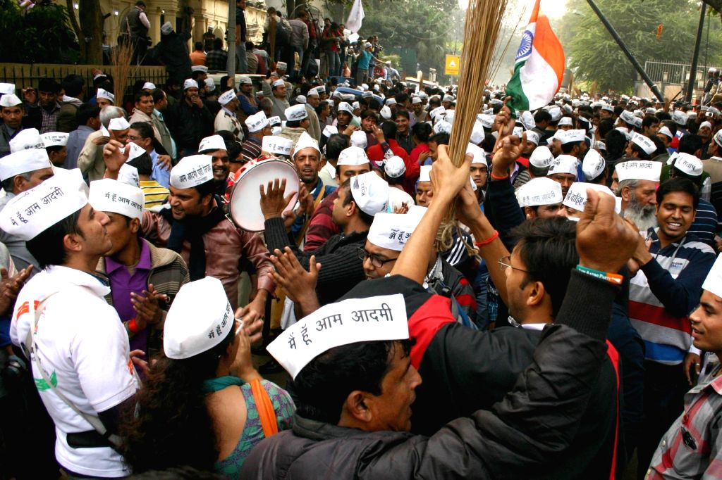 Aam Aadmi Party (AAP) supporters celebrate after a stunning performance of the party in Delhi Assembly Polls in New Delhi on Dec. 8, 2013.