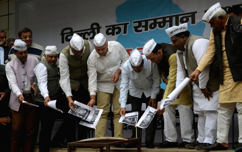Aam Aadmi Party (AAP) workers led by Delhi Chief Minister and party leader Arvind Kejriwal burns BJP's manifesto during a protest in New Delhi, on March 13, 2019. Also seen Delhi Deputy ... - Arvind Kejriwal