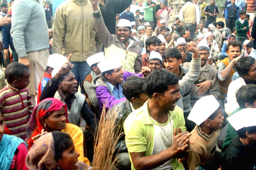 Aam Aadmi Party (AAP) workers protest against demolition of a slum in Mayur Vihar Phase -1 of New Delhi on Dec.20, 2013.
