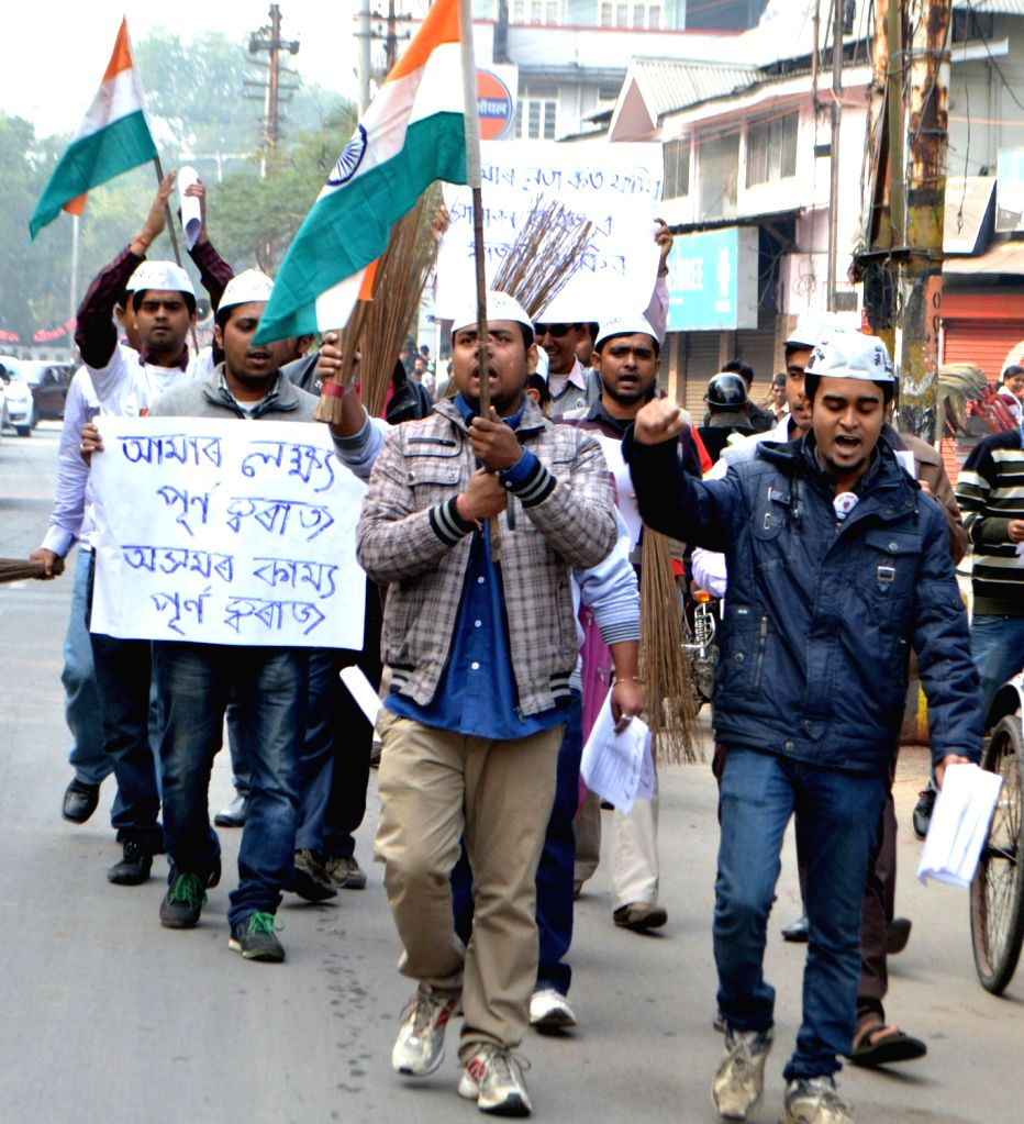 Aam Aadmi Party (AAP) workers take out a `Swaraj` awareness rally in Guwahati on Dec.20, 2013.