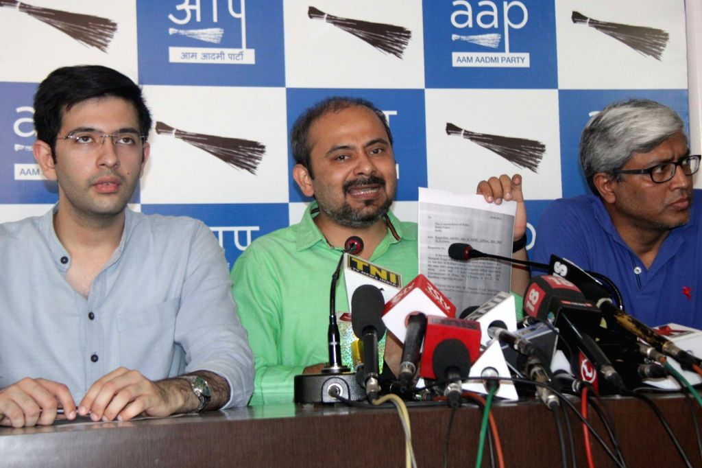 AAP leader Dilip Pandey addresses a press conference in New Delhi on June 25, 2016. Also seen AAP leaders Ashutosh and Raghav Chadha. - Dilip Pandey