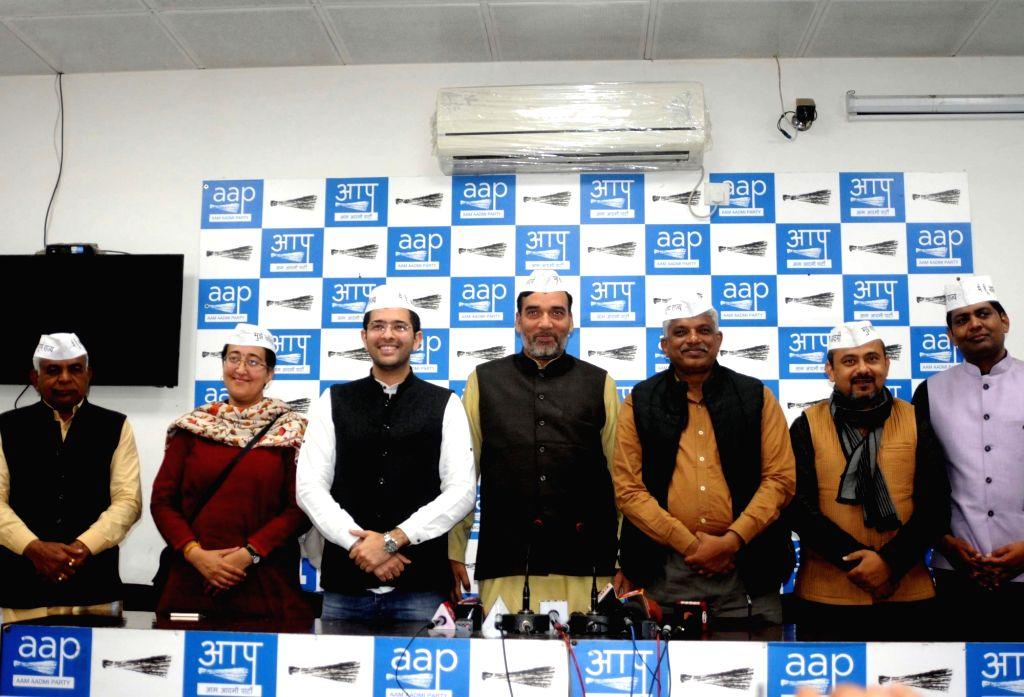 AAP leader Gopal Rai with Pankaj Gupta, Dilip Pandey, Atishi, Brajesh Goel, Gugan Singh and Raghav Chadha during a press conference in New Delhi on March 2, 2019. - Gopal Rai, Pankaj Gupta, Dilip Pandey and Gugan Singh