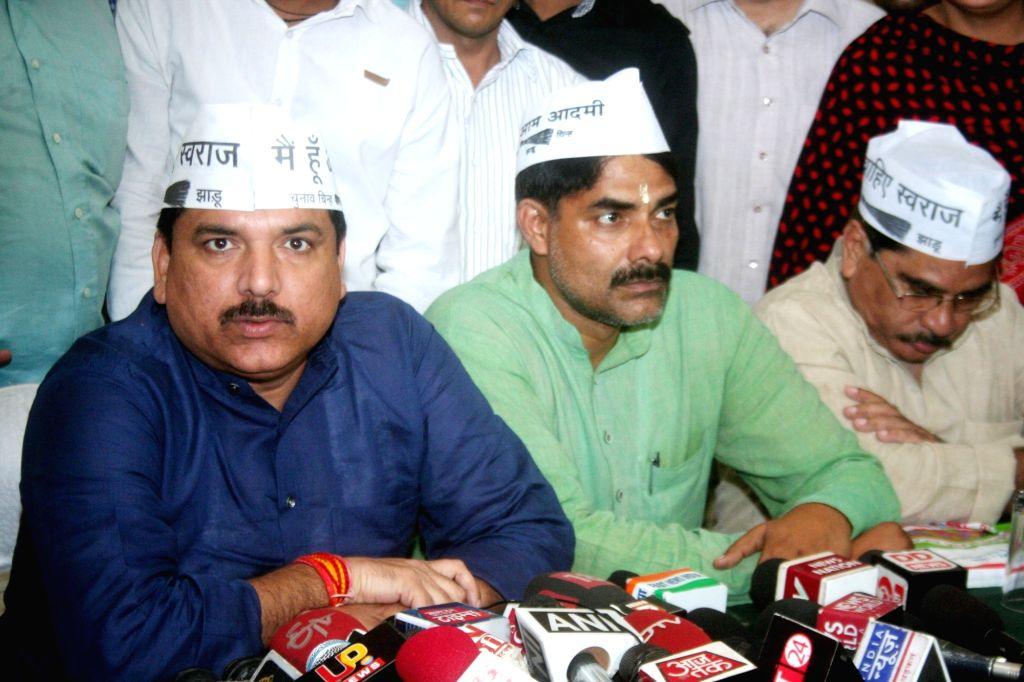 AAP leader Sanjay Singh addresses a press conference in Varanasi, on May 26, 2016. - Sanjay Singh