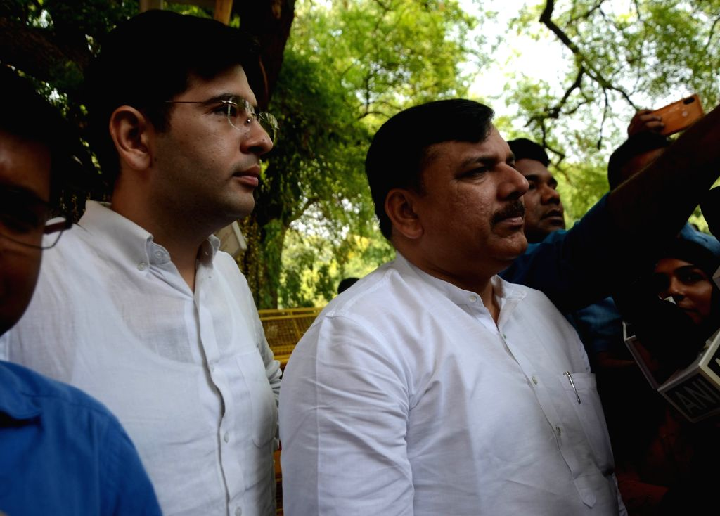AAP leaders Raghav Chadha and Sanjay Singh talk to media persons after meeting the Chief Election Commissioner (CEC) in New Delhi, on May 18, 2019. - Sanjay Singh