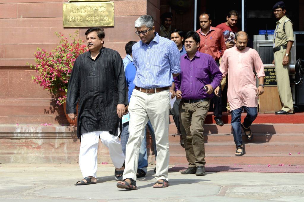 AAP leaders Sanjay Singh and Ashutosh come out of South Block in New Delhi, on Oct 20, 2015. - Sanjay Singh