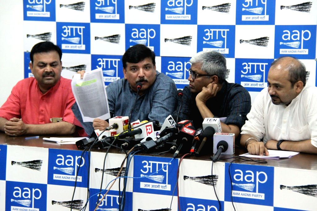 AAP leaders Sanjay Singh, Ashutosh and Dilip Pandey address a press conference in New Delhi on May 8, 2017. - Sanjay Singh and Dilip Pandey