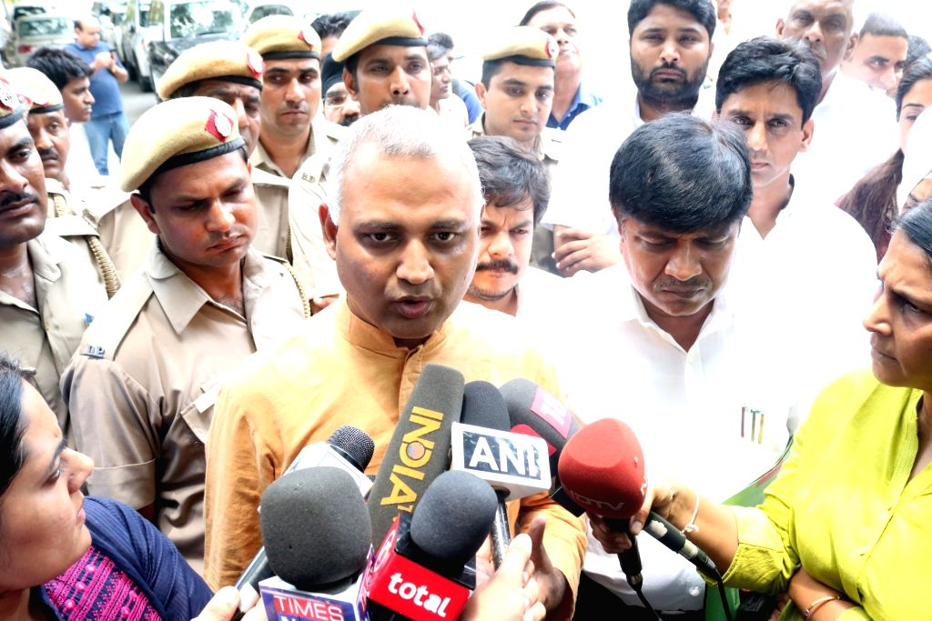 AAP leaders Somnath Bharti and Rajendra Pal Gautam come out after meeting Delhi Lt Governor Najeeb Jung in New Delhi, on June 22, 2016.