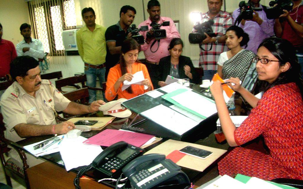 AAP legislator Alka Lamba calls on Delhi Commission for Women (DCW) chief Swati Maliwal in New Delhi, on Aug 17, 2015.