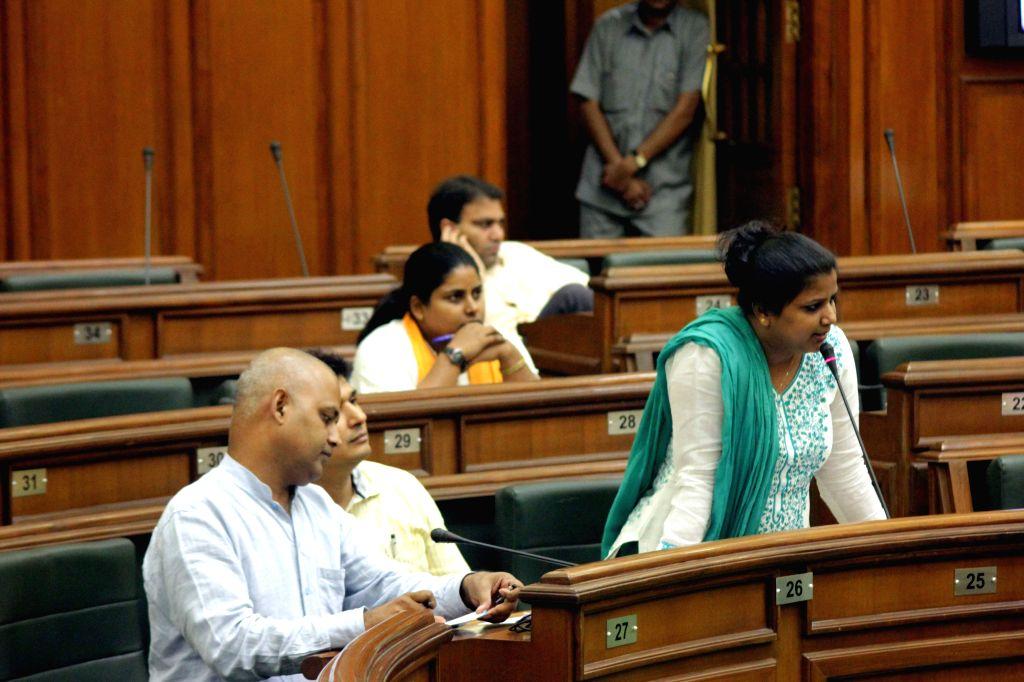 AAP legislator Rakhi Birla addresses at the Delhi Legislative Assembly on the Day 1 of the monsoon session of the house in New Delhi on Aug 3, 2015. Also seen AAP legislator Somnath ...