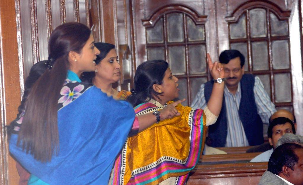 AAP legislators Alka Lamba and Rakhi Birla during the winter session of Delhi Assembly, in New Delhi on Nov 27, 2015.