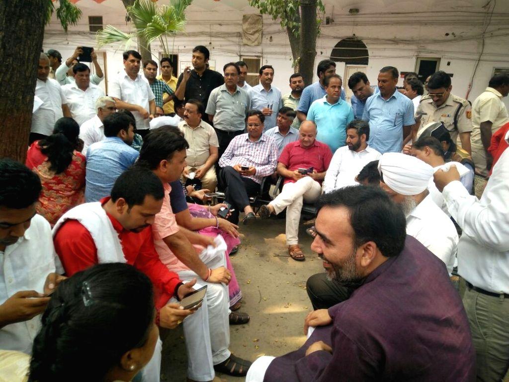 AAP legislators including Delhi Deputy Chief Minister Manish Sisodia detained at Parliament Street police station in New Delhi on June 26, 2016. Also seen Gopal Rai. - Manish Sisodia and Gopal Rai