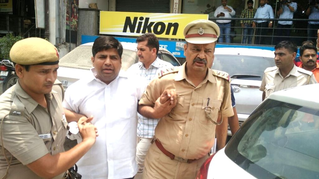 AAP MLA from Sangam Vihar Dinesh Mohaniya being taken away by police  in an alleged case of attack on locals from his residence in New Delhi, on June 25, 2016.