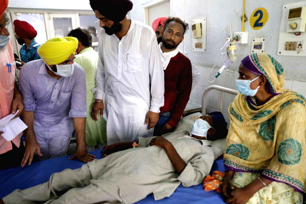 AAP MP and Punjab party president Bhagwant Mann meets people who were taken ill due to the consumption of spurious liquor at a civil hospital in Tarn Taran some 25 kms from Amritsar on ...