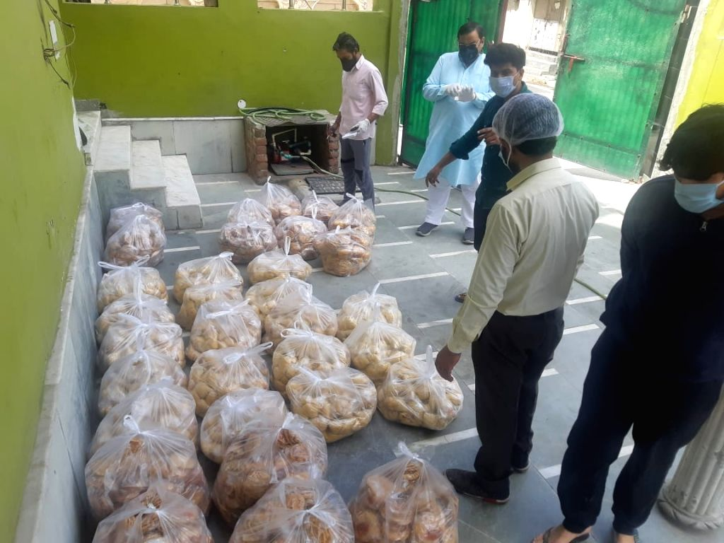 AAP Rajya Sabha MP Sushil Gupta said that he is running a community kitchen in Hiran Kudna village in West Delhi and feeding 2000 people a day in Jhuggi clusters where most of the daily wagers live ... - Sushil Gupta