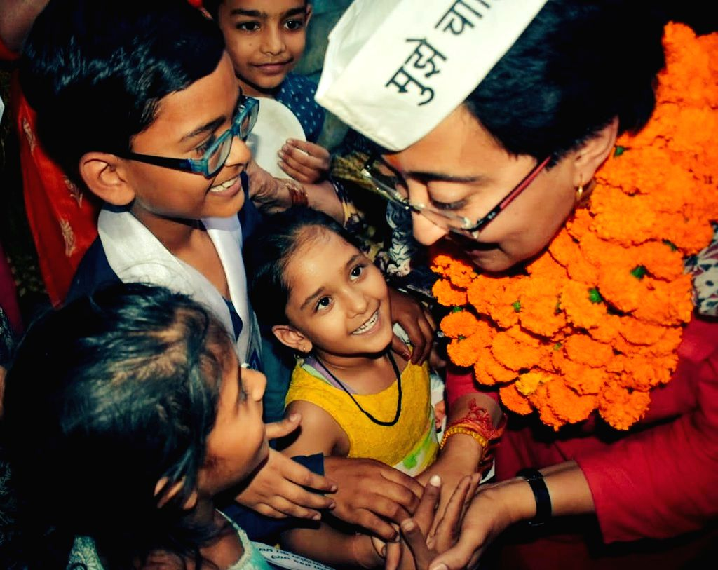AAP's Lok Sabha candidate from East Delhi, Atishi Marlena reaches out to her young supporters during an election campaign for the forthcoming Lok Sabha elections, in New Delhi on May 1, ...