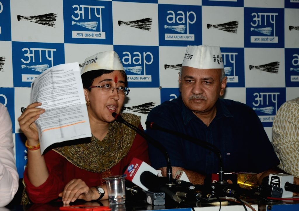 AAP's Lok Sabha candidate from East Delhi, Atishi Marlena accompanied by Delhi Deputy Chief Minister Manish Sisodia and party leader Saurabh Bhardwaj, addresses a press conference, in New ... - Manish Sisodia and Saurabh Bhardwaj