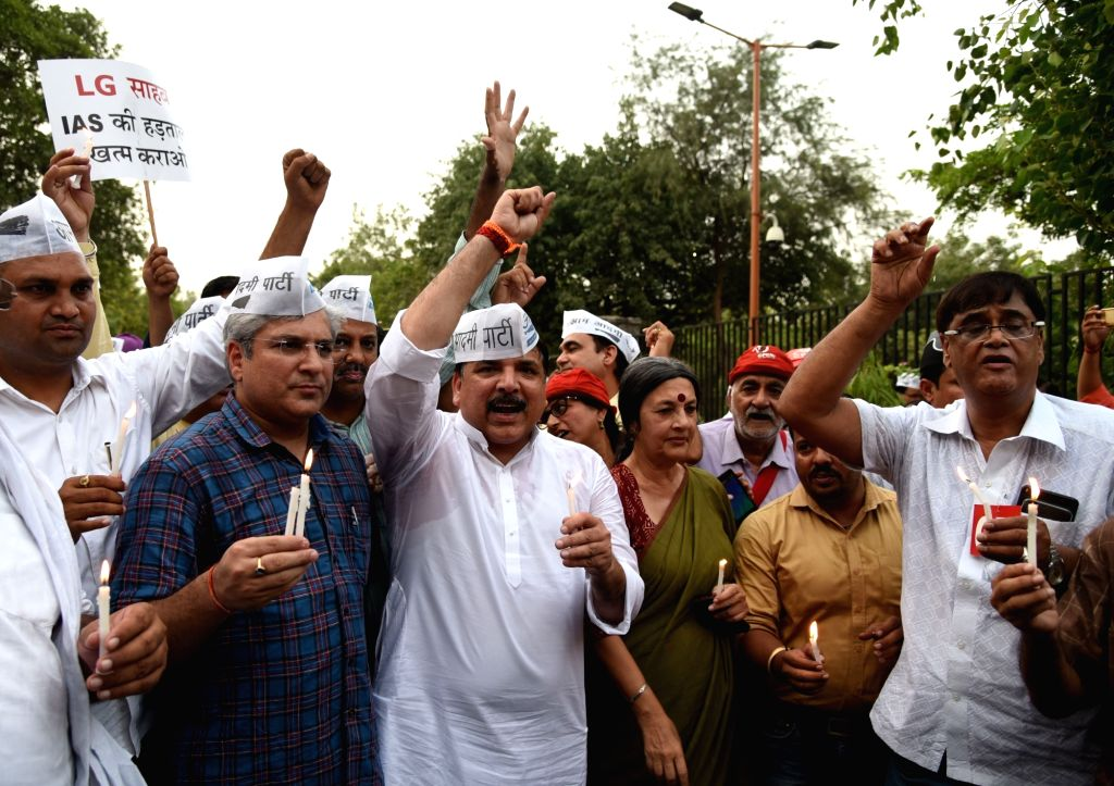 AAP's Sanjay Singh, Kailash Gehlot and others with CPI-M leader Brinda Karat participate in a candle march in support of Delhi Chief Minister Arvind Kejriwal at Raj Ghat in New Delhi, on ... - Arvind Kejriwal and Sanjay Singh