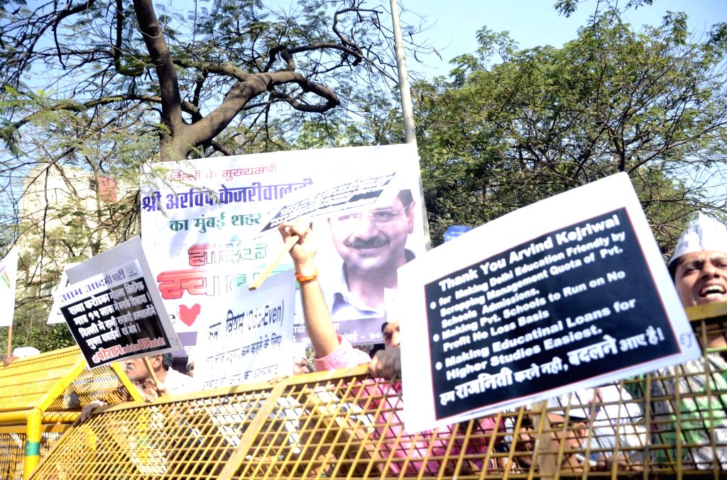 AAP supporters gather ouside the Kurla magistrate court where Delhi Chief Minister and AAP leader Arvind Kejriwal appeared inconnection with a case for holding an `unscheduled` rally during ... - Arvind Kejriwal