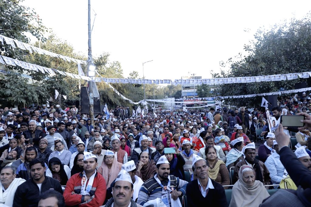 AAP workers and supporters during Delhi Chief Minister and party national convenor Arvind Kejriwal's public meeting ahead of February 8 Assembly elections, in North West Delhi's Rohini ... - Arvind Kejriwal