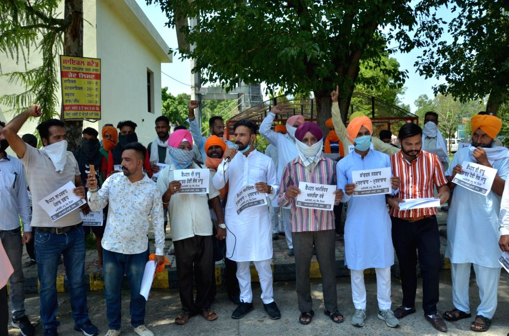 AAP workers protest against the Punjab Government after a hooch tragedy claimed 86 lives in the three districts of Tarn Taran, Amritsar rural and Gurdaspur districts of Punjab; in Amritsar ...
