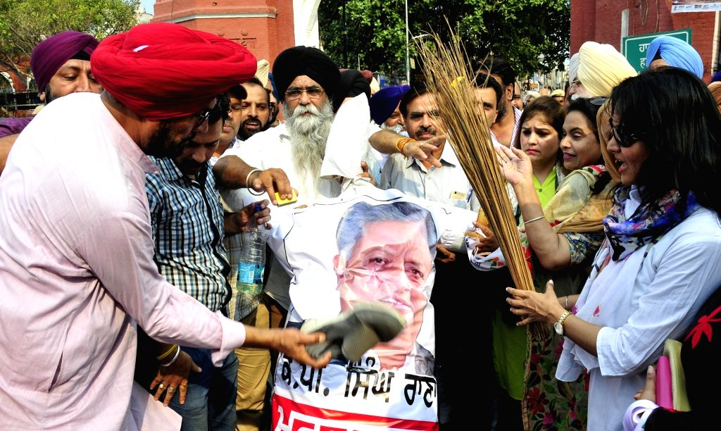 AAP workers stage a demonstration against Punjab Speaker Rana KP Singh in Amritsar, on June 23, 2017. - Rana K