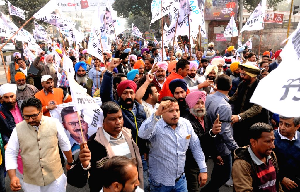 AAP workers stage a demonstration against the Amarinder Singh led Punjab government in Amritsar, on Dec 6, 2018. - Amarinder Singh