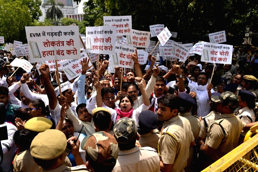 AAP workers stage a demonstration outside Election Commission office in New Delhi on May 11, 2017.