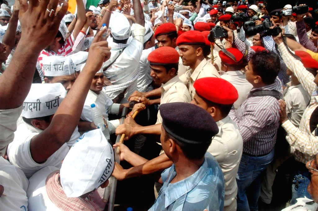 AAP workers stage a demonstration to press for their demands in Patna on Aug 16, 2016.
