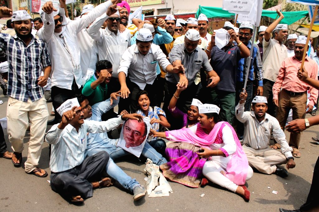 AAP workers stage a demonstration to protest against the one percent excise duty proposed by Finance Minister Arun Jaitley in the 2016-17 national budget, in Nagpur, on April 5, 2016. - Arun Jaitley