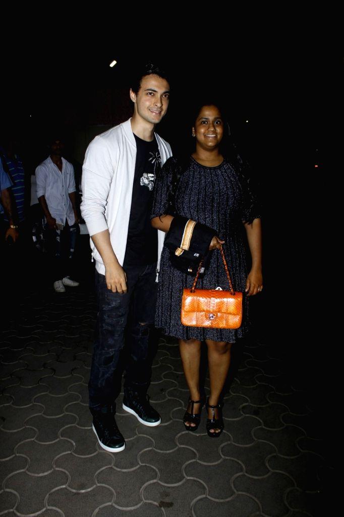 Aayush Sharma along with his wife Arpita Khan during the screening of film Tubelight, in Mumbai, on June 22, 2017. - Aayush Sharma and Arpita Khan