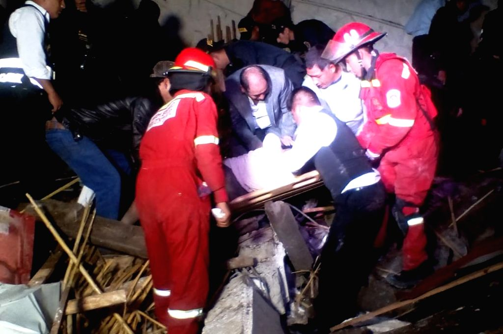 ABANCAY (PERU), Jan. 27, 2019 Photo provided by the National Institute of Civil Defense (Indeci) shows rescuers working at the site where the wall and roof of a hotel collapsed during a ...