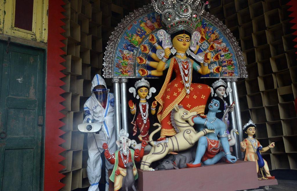 Abasar Sarbojanin Durga Puja pandal being sanitised amid COVID-19 pandemic ahead of Durga Puja celebrations, in Kolkata on Oct 13, 2020.