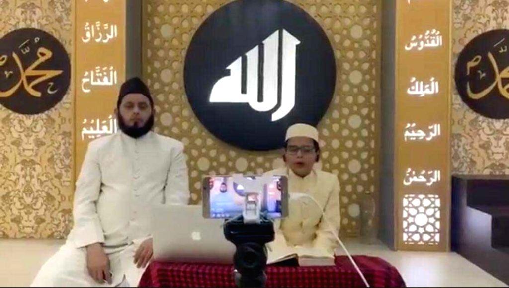 Abdul Hai Rashid reciting Quran ( seen with his father Maulana Khalid Rashid Firangi Mahali)