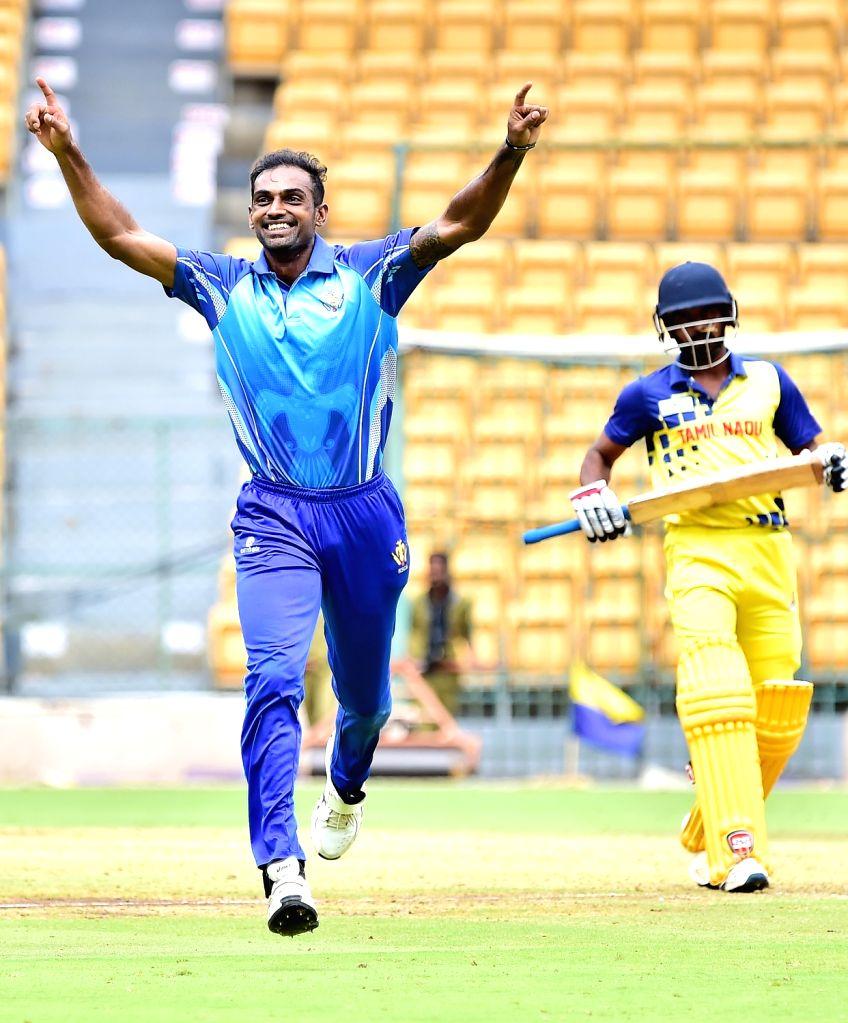 Abhimanyu Mithun of Karnataka celebrates the wicket of Tamil Nadu during Vijay Hazare Trophy final match between Karnataka and Tamil Nadu at M Chinnaswamy Stadium, in Bengaluru on Oct 25, ...