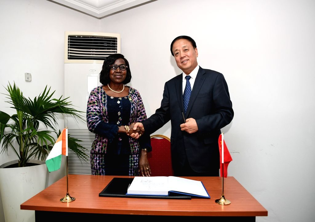 ABIDJAN, Nov. 15, 2019 - Wu Weihua (R), vice chairman of China's National People's Congress Standing Committee, shakes hands with Assa Emilienne Bobi, vice chairman of the Senate of Cote d'Ivoire, in ...