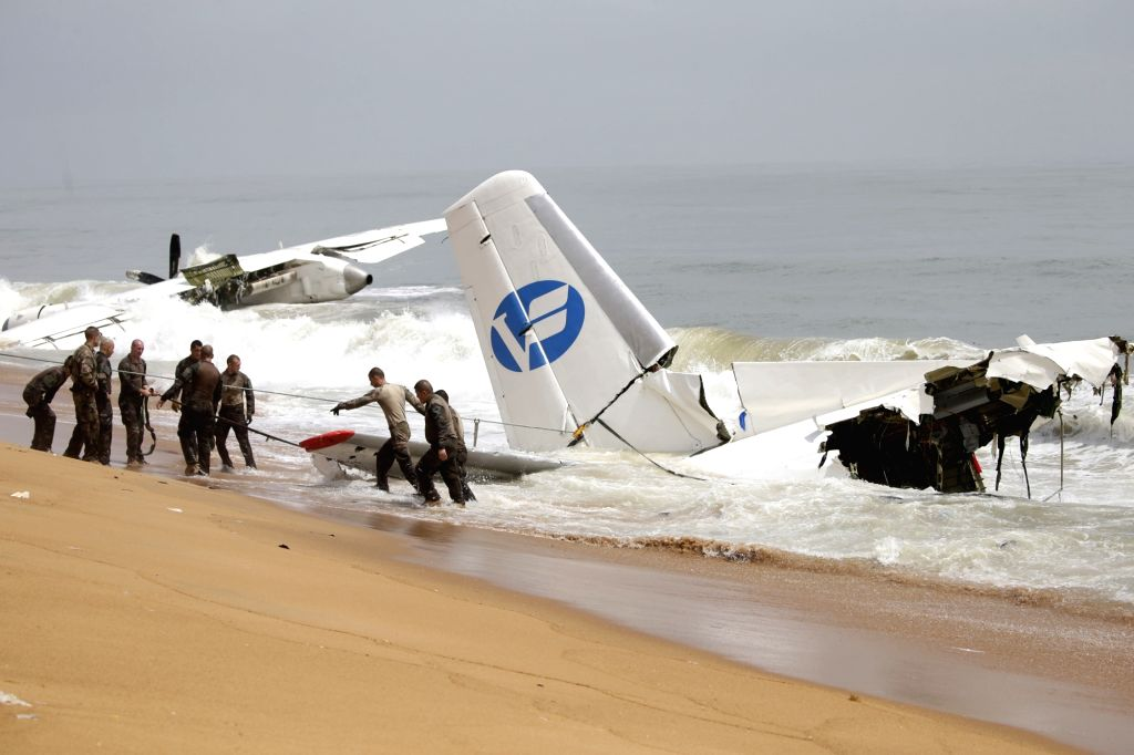 ABIDJAN, Oct. 14, 2017 - French soldiers work at the crashed plane scene in the ocean not far from an airport in Abidjan, Cote d'Ivoire, Oct. 14, 2017. A plane with 10 people on board on Saturday ...