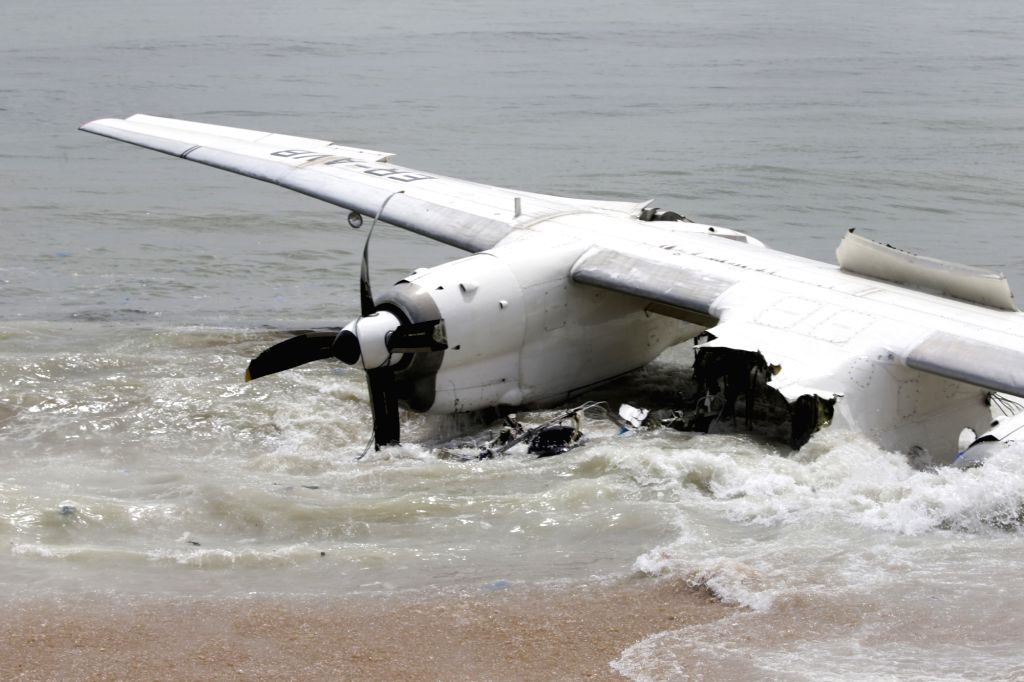 ABIDJAN, Oct. 14, 2017 - Photo taken on Oct. 14, 2017 shows the crashed plane in the ocean not far from an airport in Abidjan, Cote d'Ivoire. A plane with 10 people on board on Saturday morning ...