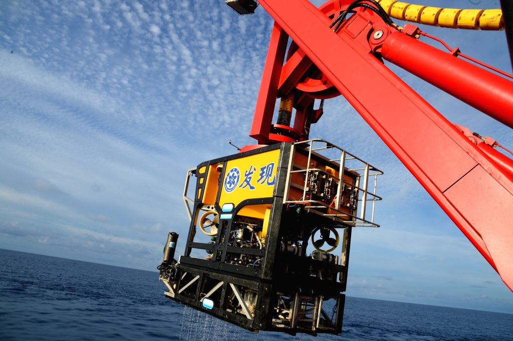 """ABOARD KEXUE, July 25, 2017 - The unmanned submersible """"Faxian"""" is elevated from the sea aboard Chinese research vessel """"Kexue"""" during an operation to detect a cold seep in the ..."""